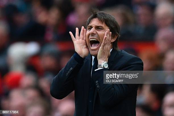 Chelsea's Italian head coach Antonio Conte shouts from the touchline during the English Premier League football match between Manchester United and...