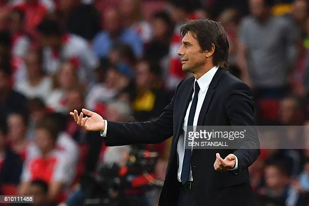 Chelsea's Italian head coach Antonio Conte watches from the touchline during the English Premier League football match between Arsenal and Chelsea at...