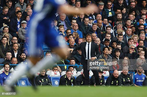 Chelsea's Italian head coach Antonio Conte watches from the touchline during the English Premier League football match between Chelsea and Leicester...