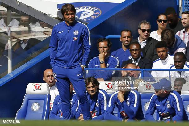 Chelsea's Italian head coach Antonio Conte watches from the touchline after going three down during the English Premier League football match between...