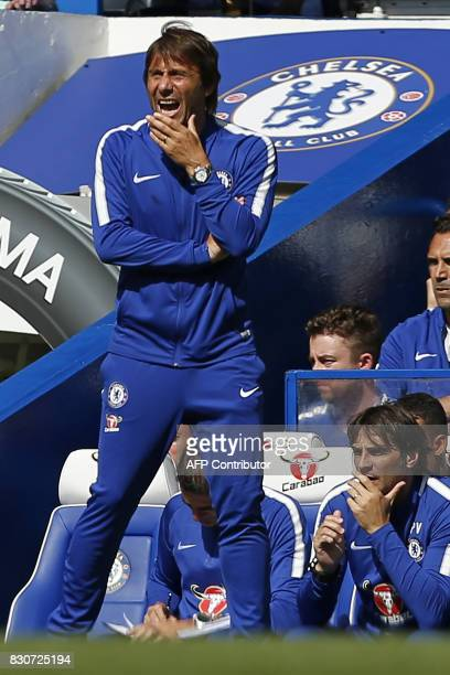 Chelsea's Italian head coach Antonio Conte watches from the touchline during the English Premier League football match between Chelsea and Burnley at...