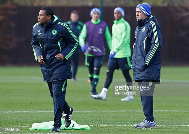 Chelsea's Italian Manager Carlo Ancelotti and first team assistant coach Michael Emenalo wathc the players during a team training session at the...