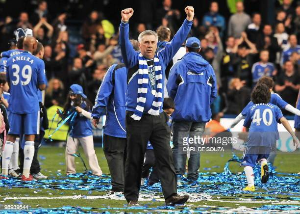 Chelsea's Italian manager Carlo Ancelotti celebrates after Chelsea win the title with a 80 victory over Wigan Athletic in the English Premier League...