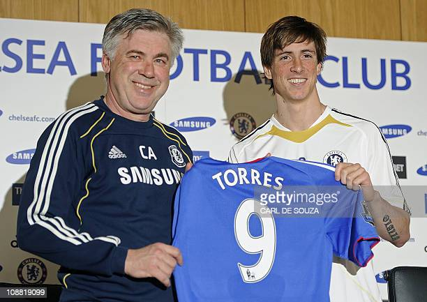 Chelsea's Italian manager Carlo Ancelotti poses with new signing Spanish striker Fernando Torres at Chelsea's training grounds in Cobham Surrey on...