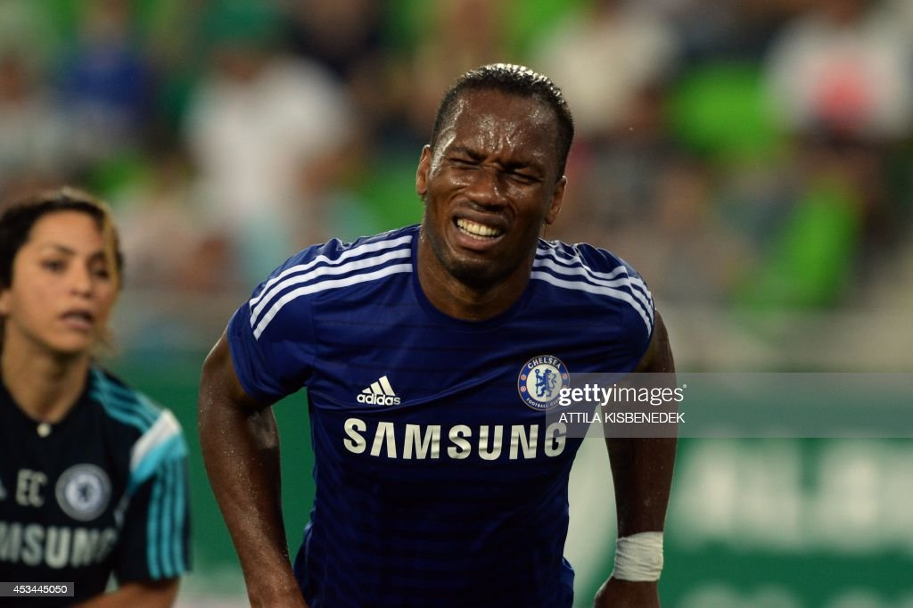 Chelsea's Ivorian forward Didier Drogba grimaces in pain as he leaves the pitch at the Groupama Arena new football stadium in Budapest during the first international football match here between the local Hungarian team of TC Ferencvaros and English Premier League club FC Chelsea on August 10, 2014.