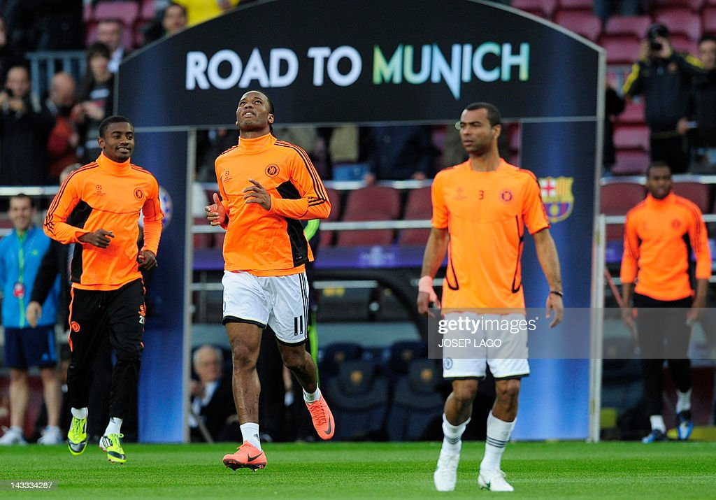Chelsea's Ivorian forward Salomon Kalou, Chelsea's Ivorian forward Didier Drogba and Chelsea's defender Ashley Cole arrive on the pitch for the UEFA Champions League second leg semi-final football match Barcelona against Chelsea at the Cam Nou stadium in Barcelona on April 24, 2012.