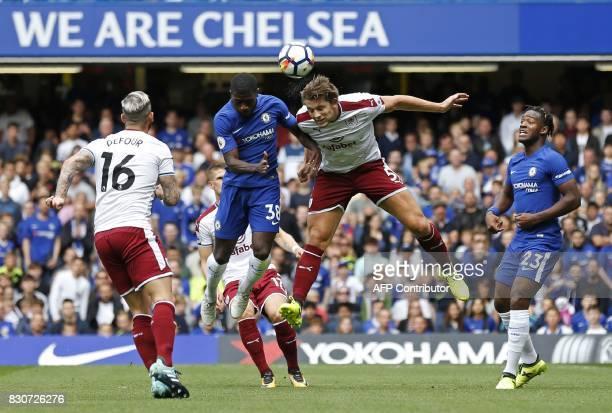Chelsea's Ivorian midfielder Jeremie Boga vies with Burnley's English defender James Tarkowski during the English Premier League football match...