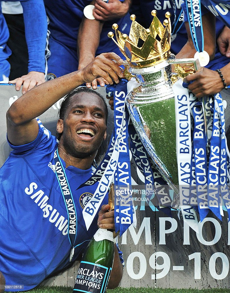 Chelsea's Ivorian striker Didier Drogba celebrates with the Premier league trophy after they win the title with a 8-0 victory over Wigan Athletic in the English Premier League football match at Stamford Bridge, West London, England, on May 9, 2010. Chelsea finished the season one pont ahead of 2009 Champions, Manchester United. Drogba finish as the leading goal-scorer. AFP PHOTO/CARL DE SOUZA FOR EDITORIAL USE ONLY Additional licence required for any commercial/promotional use or use on TV or internet (except identical online version of newspaper) of Premier League/Football League photos. Tel DataCo +44 207 2981656. Do not alter/modify photo.