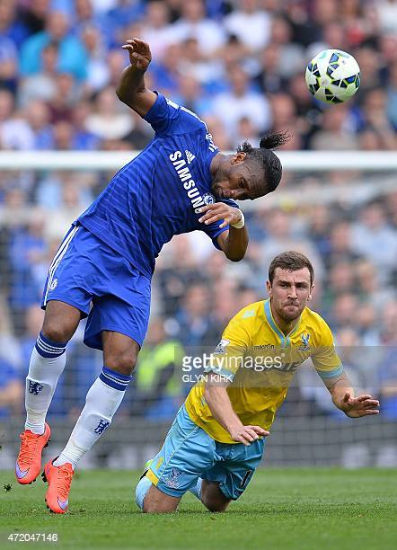 Chelsea's Ivorian striker Didier Drogba heads the ball past Crystal Palace's Scottish midfielder James McArthur during the English Premier League...
