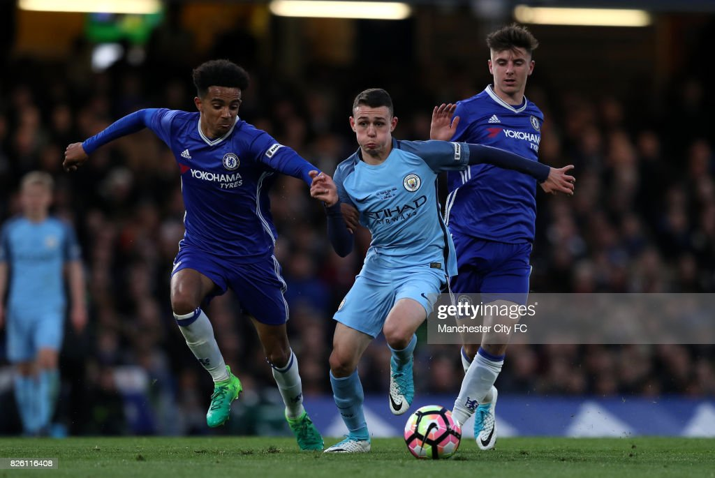 Chelsea's Jacob Maddox(left) and Mason Mount (right) Manchester City's Phil Foden battle for the ball.