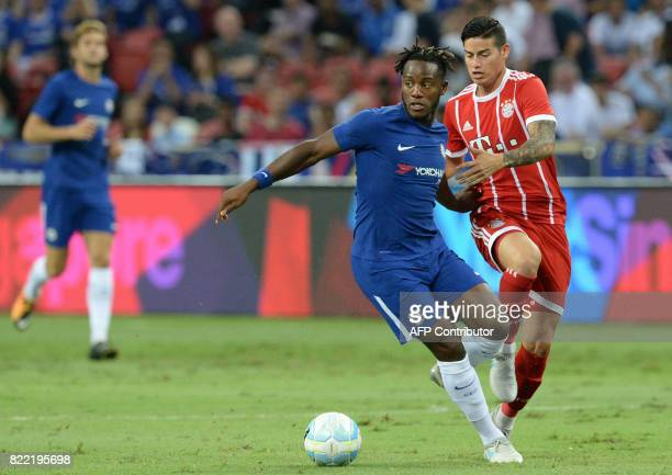 Chelsea's Jakes ClarkeSalter and Bayern Munich's James Rodriguez vie for the ball during the International Champions Cup football match between...