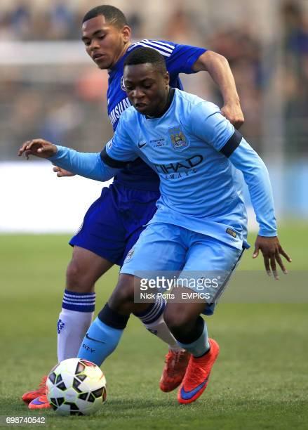 Chelsea's Jay Dasilva and Manchester City's Aaron Nemane battle for the ball