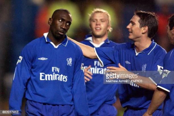 Chelsea's Jimmy Floyd Hasselbaink celebrates with Eidur Gudjohnsen and Frank Lampard after scoring the third goal against Sunderland