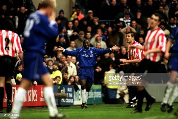 Chelsea's Jimmy Floyd Hasselbaink shrugs his shoulders summing up Chelsea's afternoon after again not getting the final pass in front of an open goal