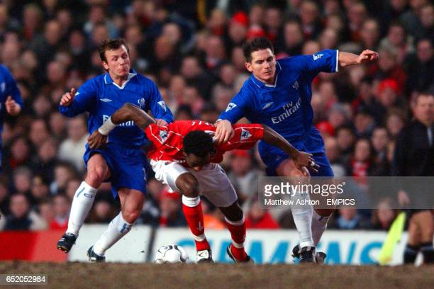 Chelsea's Jody Morris and Frank Lampard get the ball of Charlton Athletic's Jason Euell