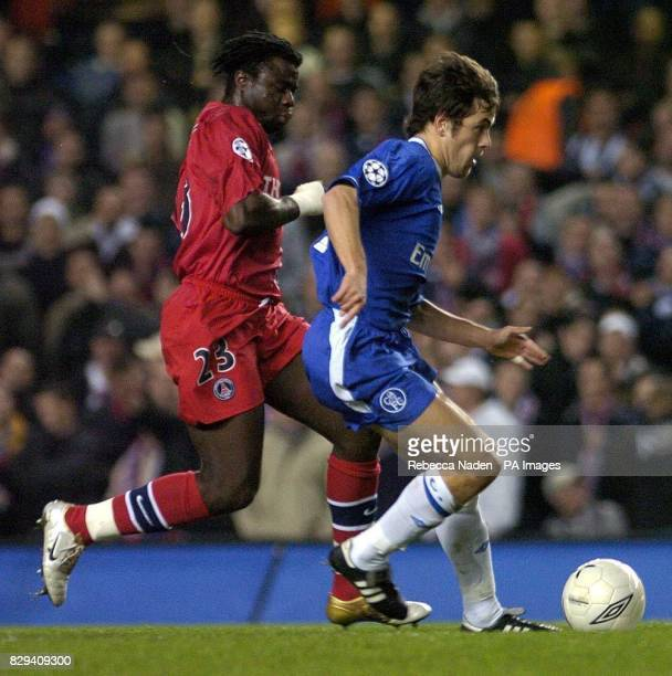 Chelsea's Joe Cole and Paris SaintGermain's M'Bami Modeste during their UEFA Champions League Group H match at Stamford Bridge west London THIS...