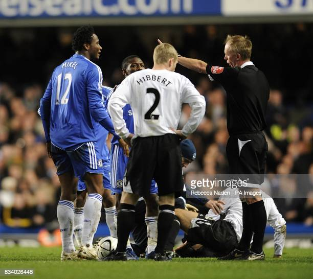 Chelsea's John Mikel Obi is ordered off the pitch after being shown the red card by referee Peter Walton