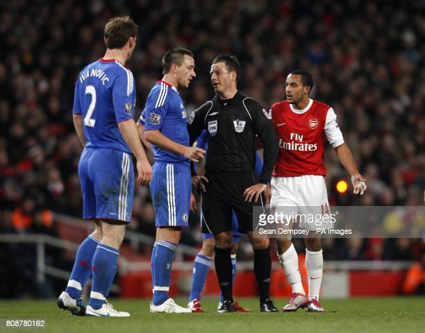Chelsea's John Terry and Arsenal's Theo Walcott have a word with referee Mark Clattenburg