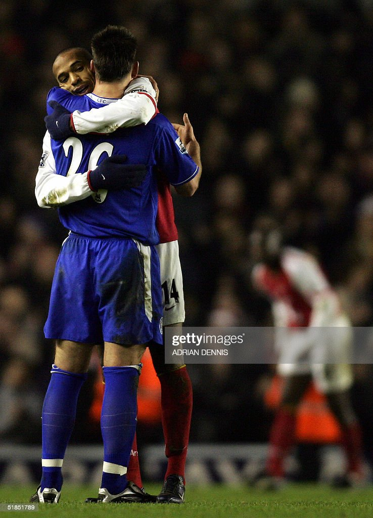 Chelsea's John Terry (front) and Arsenal's Thierry Henry embrace at the final whistle after the Premiership match at Highbury in London 12 December 2004. Both players scrored in the game which ended 2-2 leaving Chelsea top of the Premiership. AFP PHOTO Adrian DENNIS / No telcos, website uses subject to subscription of a license with FAPL on www.faplweb.com <http://www.faplweb.com>