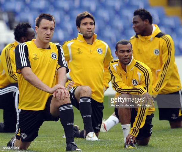 Chelsea's John Terry and Ashley Cole warm up with teammates during a training session at Stamford Bridge London