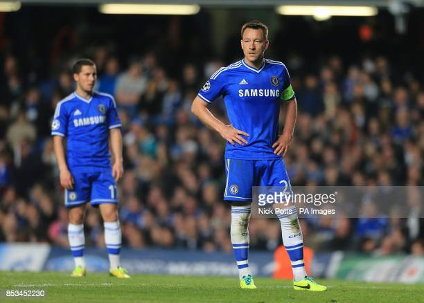 Chelsea's John Terry and Eden Hazard stand dejected late in the game