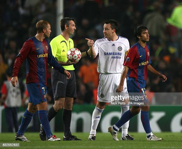 Chelsea's John Terry argues with referee Stefano Farina as Barcelona's Eidur Gudjohnsen looks on