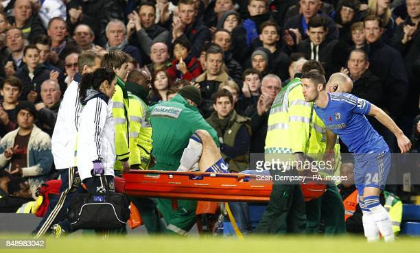 Chelsea's John Terry is carried off the pitch on a stretcher after picking up a injury in a collision with Liverpool's Luis Suarez
