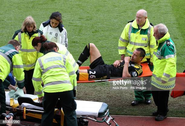 Chelsea's John Terry leaves the pitch on a stretcher after picking up an injury