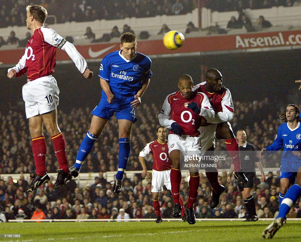 Chelsea's John Terry (2nd L) rises over Arsenal's Thierry Henry (C) and Sol Campbell (2nd R) to score a goal during the Premiership match at Highbury in London 12 December 2004. AFP PHOTO Adrian DENNIS / No telcos, website uses subject to subscription of a license with FAPL on www.faplweb.com <http://www.faplweb.com>
