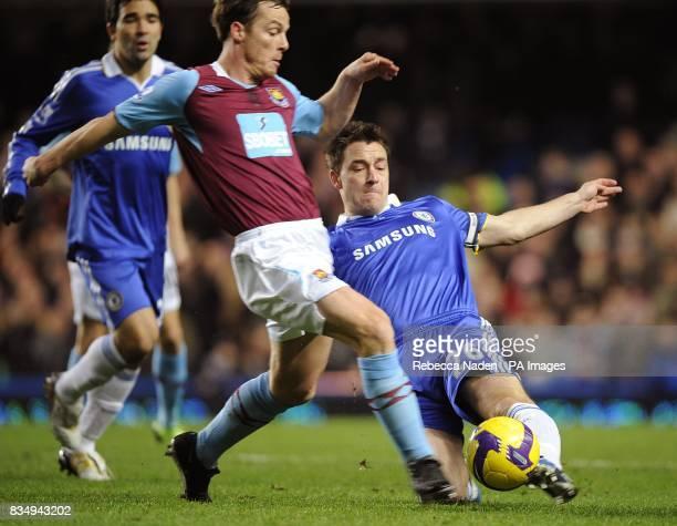 Chelsea's John Terry tackles West Ham United's Scott Parker