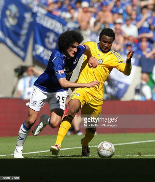 Chelsea's Jon Obi Mikel and Everton's Marouane Fellaini battle for the ball