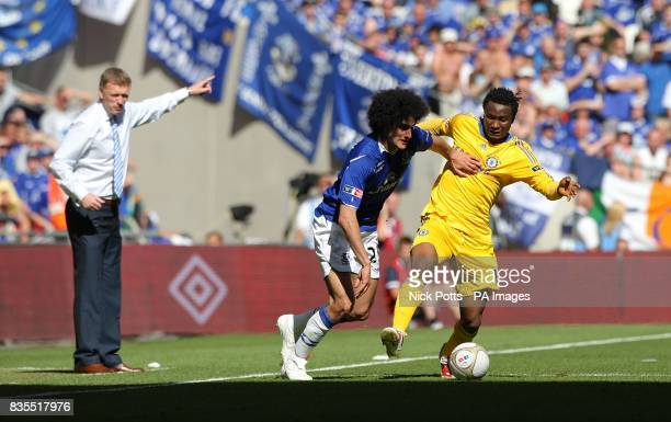 Chelsea's Jon Obi Mikel and Everton's Marouane Fellaini battle for the ball as Everton manager David Moyes gestures on the touchline