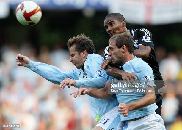 Chelsea's Jose Bosingwa jumps high with Manchester City's Dietmar Hamann and Pablo Zabaleta in a battle for the ball