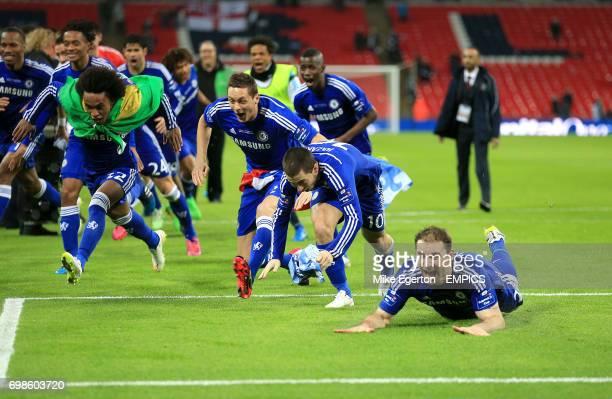 Chelsea's Juan Cuadrado Willian Nemanja Matic Eden Hazard and Branislav Ivanovic dive on the pitch whilst celebrating their victory