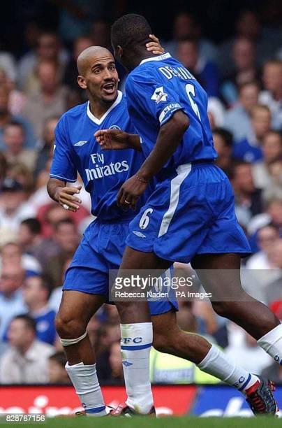 Chelsea's Juan Sebastian Veron and Marcel Desailly celebrate their team's first goal against Leicester City during their FA Premiership match at...