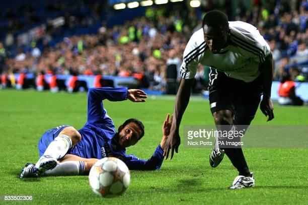 Chelsea's Juliano Belletti and Rosenborg's Yssouf Kone battle for the ball