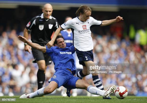 Chelsea's Juliano Belletti and Tottenham Hotspur's Luka Modric battle for the ball