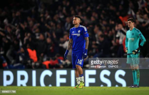 Chelsea's Kenedy and Chelsea goalkeeper Thibaut Courtois look dejected after seeing their side concede a second goal of the game