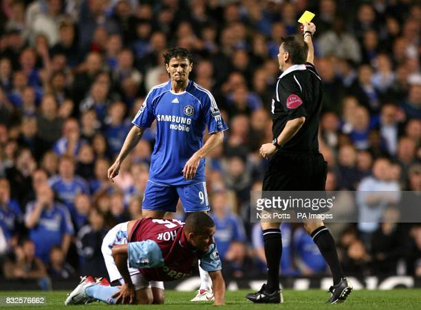 Chelsea's Khalid Boulahrouz is booked by referee Mark Halsey for a foul on Gabriel Agbonlahor
