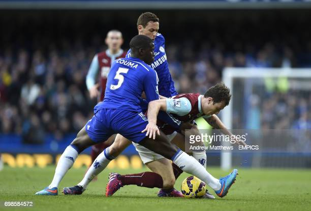 Chelsea's Kurt Zouma and Nemanja Matic battle for the ball with Burnley's Ashley Barnes