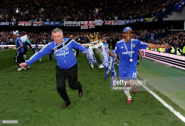 Chelsea's manager Carlo Ancellotti and Florent Malouda celebrate with the trophy after winning the league with an 80 victory during the Barclays...