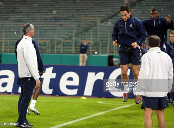 Chelsea's Manager Claudio Ranieri watches as his players are put through their paces
