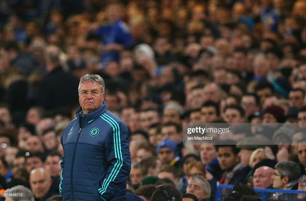 Chelseaâs manager Gus Hidddink looks on during the UEFA Champions League Round of 16 Second Leg match between Chelsea and Paris Saint-Germain at Stamford Bridge on March 09, 2016 in London, England.