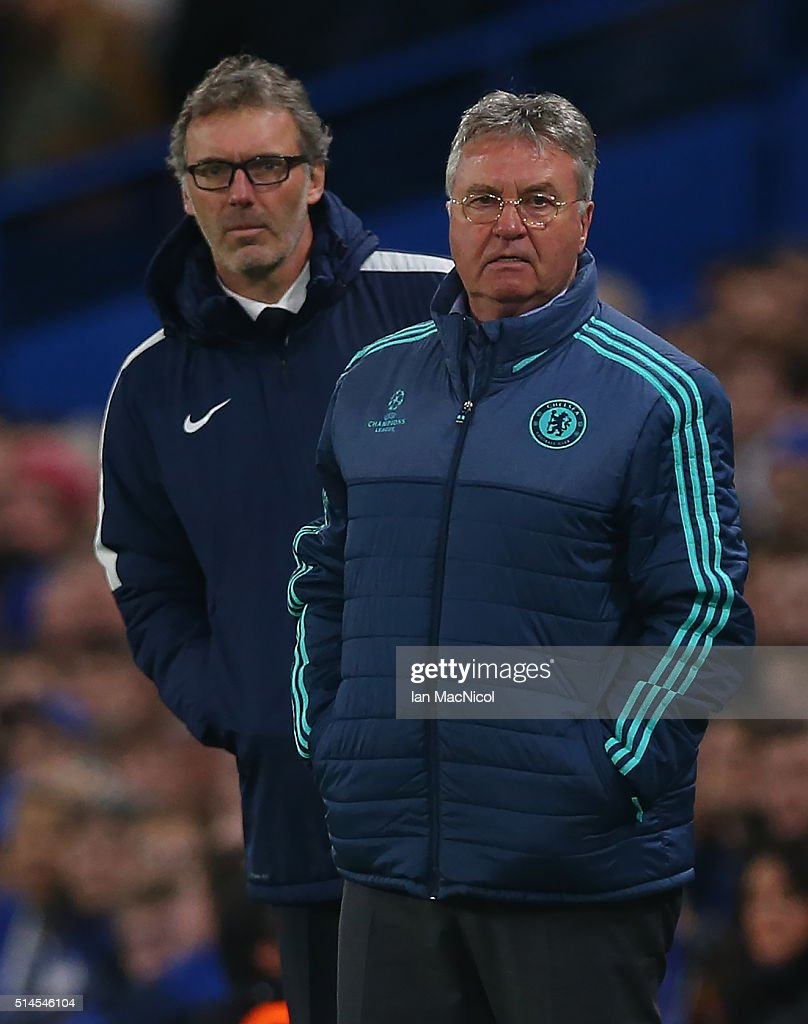 ChelseaÕs manager Gus Hidddink looks on during the UEFA Champions League Round of 16 Second Leg match between Chelsea and Paris Saint-Germain at Stamford Bridge on March 09, 2016 in London, England.