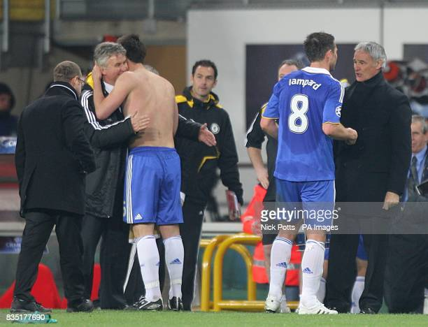 Chelsea's Manager Guus Hiddink hugs John Terry as Frank Lampard greats Juventus' Coach Claudio Ranieri after the final whistle