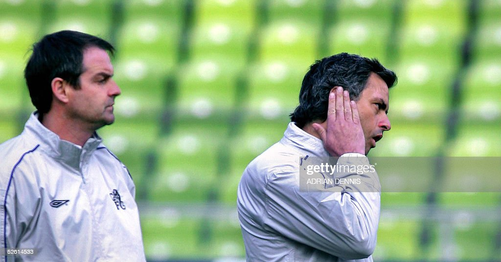 Chelsea's Manager Jose Mourinho (R) and his assistant Steve Clarke (L) lare pictured during a training session at The Olympic Stadium in Munich, 11 April 2005. Chelsea will play against Bayern Munich tomorrow in the second leg of the quarter-final of the Champions League. Mourinho is currently serving a touch line ban and the British press speculated he passed messages to his team via telephone, a breach of UEFA rules, during the first-leg game against Bayern.