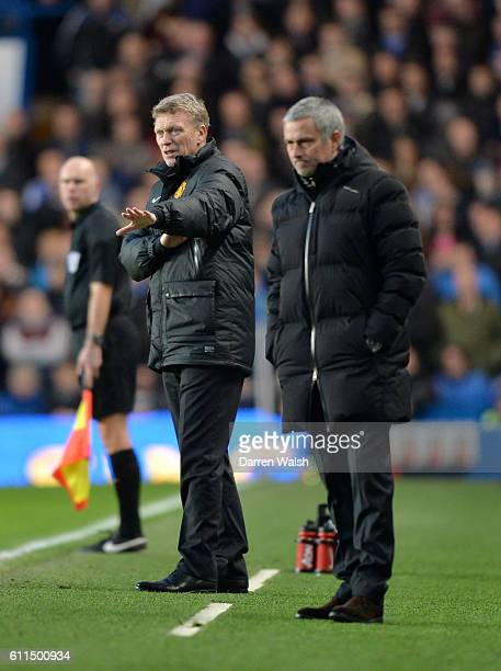 Chelsea's manager Jose Mourinho and Manchester United manager David Moyes on the touchline