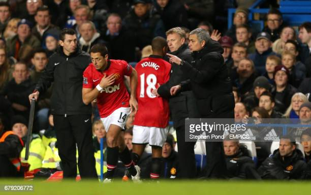 Chelsea's Manager Jose Mourinho shouts orders as Manchester United's Manager David Moyes brings on Javier Hernandez for Ashley Young