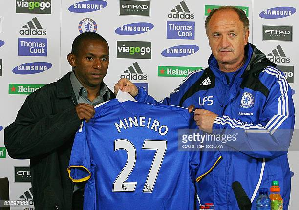 Chelsea's Manager Luiz Felipe Scolari poses with latest signing Brazilian footballer Mineiro during a photocall at the Chelsea FC training ground in...