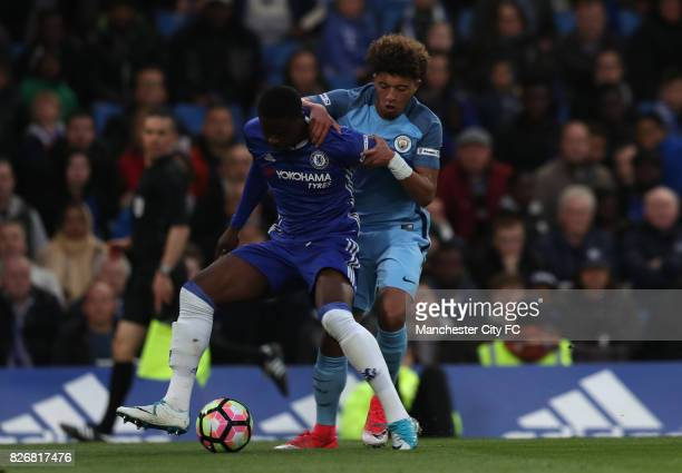 Chelsea's Marc Guehi and Manchester City's Jadon Sancho battle for the ball